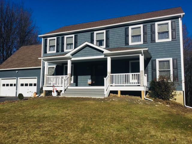 Wallkill, NY - Added a new covered porch with Trex railings and top decking. New Alside vinyl shake siding in midnight blue with black shutters.