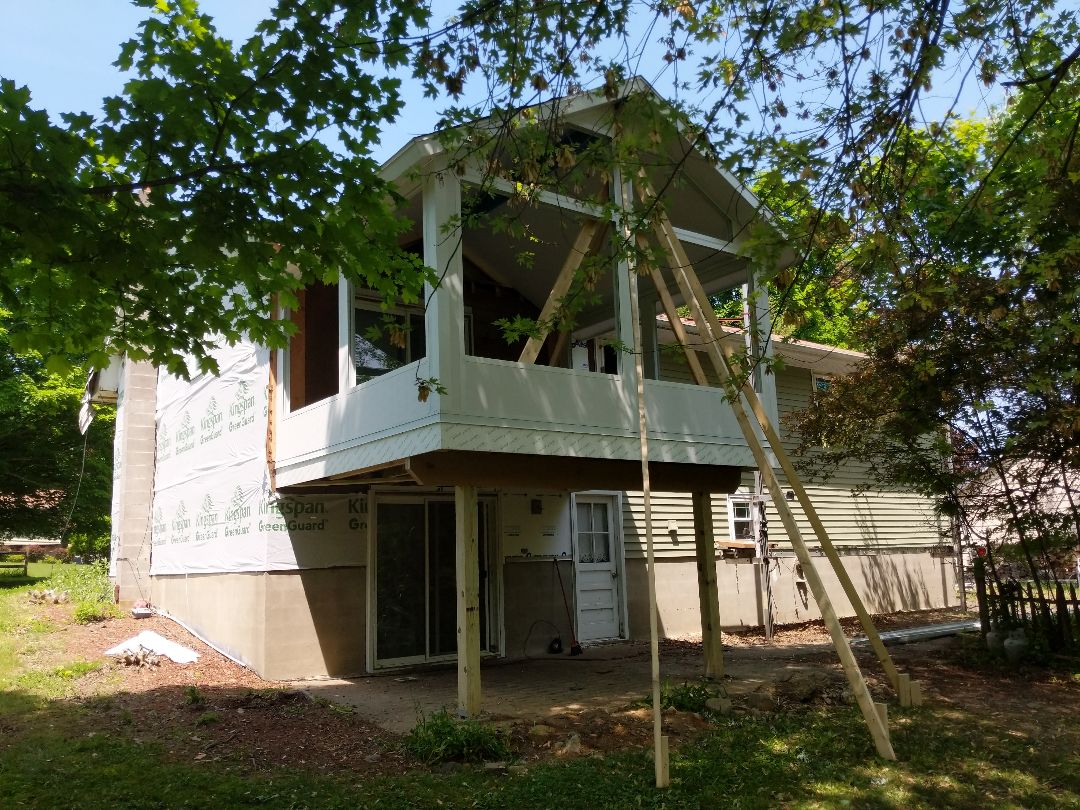Montgomery, NY - Replacing the old siding, adding energy efficient windows and a back yard Oasis in the form of a fully insulated patio room.Completion pictures of the whole house will be added soon!