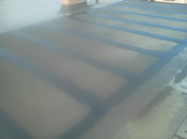 Maple Heights, OH - Flat Roof Repair: Resealed all open fasteners and seams on unit. Applied a new layer of rolled roofing over leaking areas and sealed in with roofing cement and bonding adhesive.
