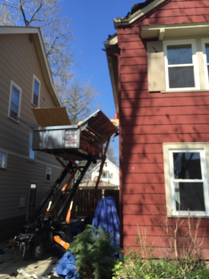 Lakewood, OH - Tight spaces are no problem with the Westside Roofing Equiptor! Well done men! New roof going on with certainteed landmark shingles. Dependability is number one when choosing materials and your roofing contractor!  Go with the pros at West Side Roofing! #sweetnewroof2016 #keepingfamilysdrysince1931