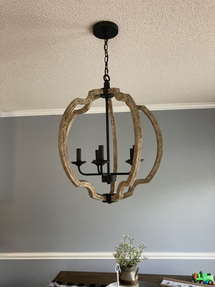Electrician replacing light fixtures