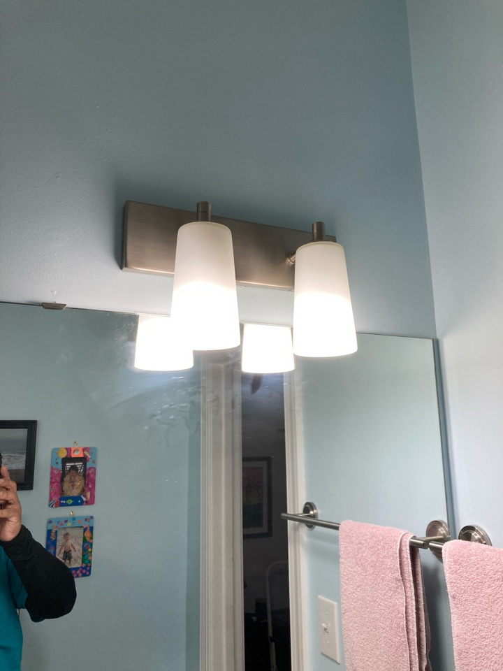 Troubleshooting bathroom light fixture that will not turn on took light down found a loose connection
