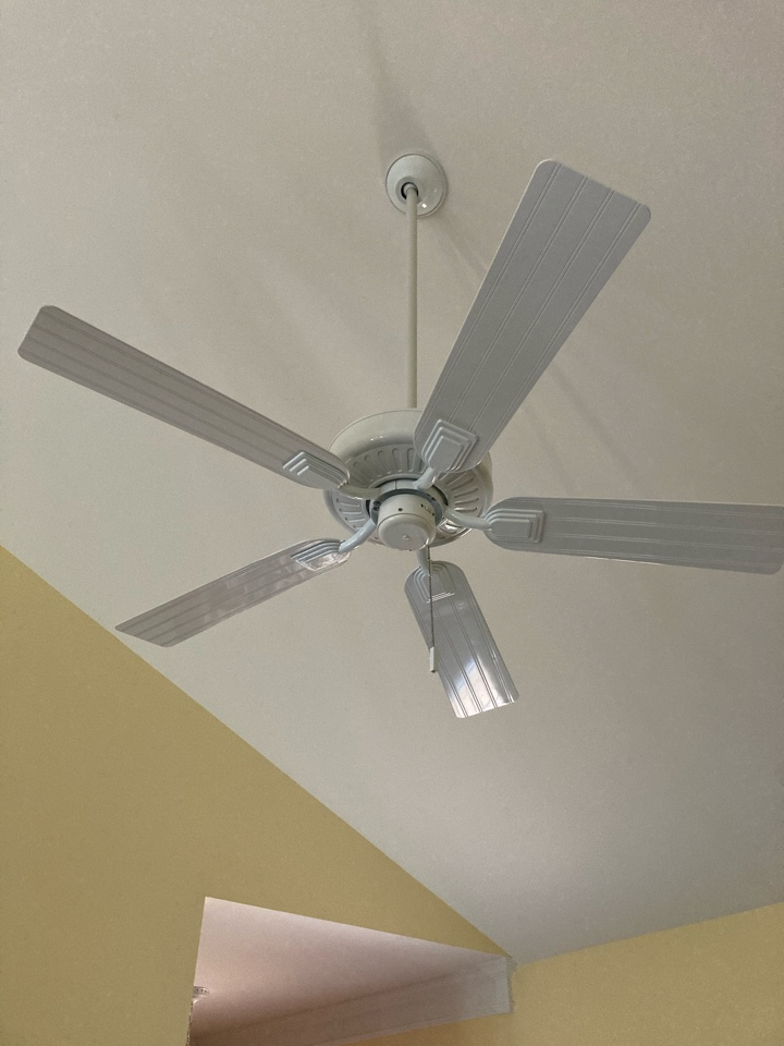 Replacing a ceiling fan in a great room.