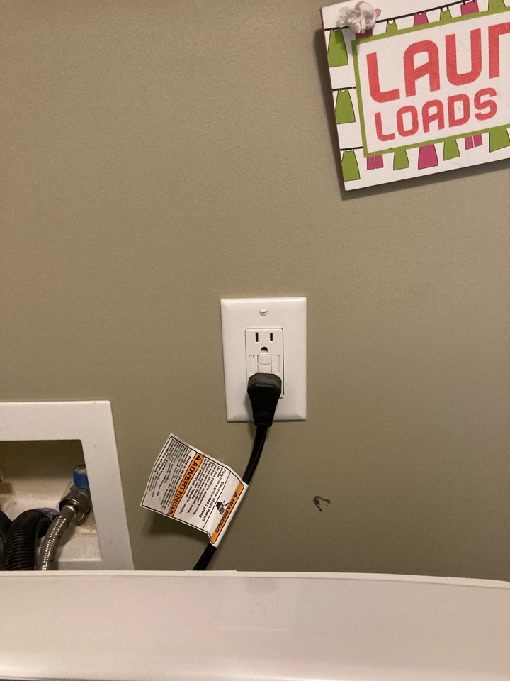 Electrician in Garner bonding gas, installing a gfci and a blank plate