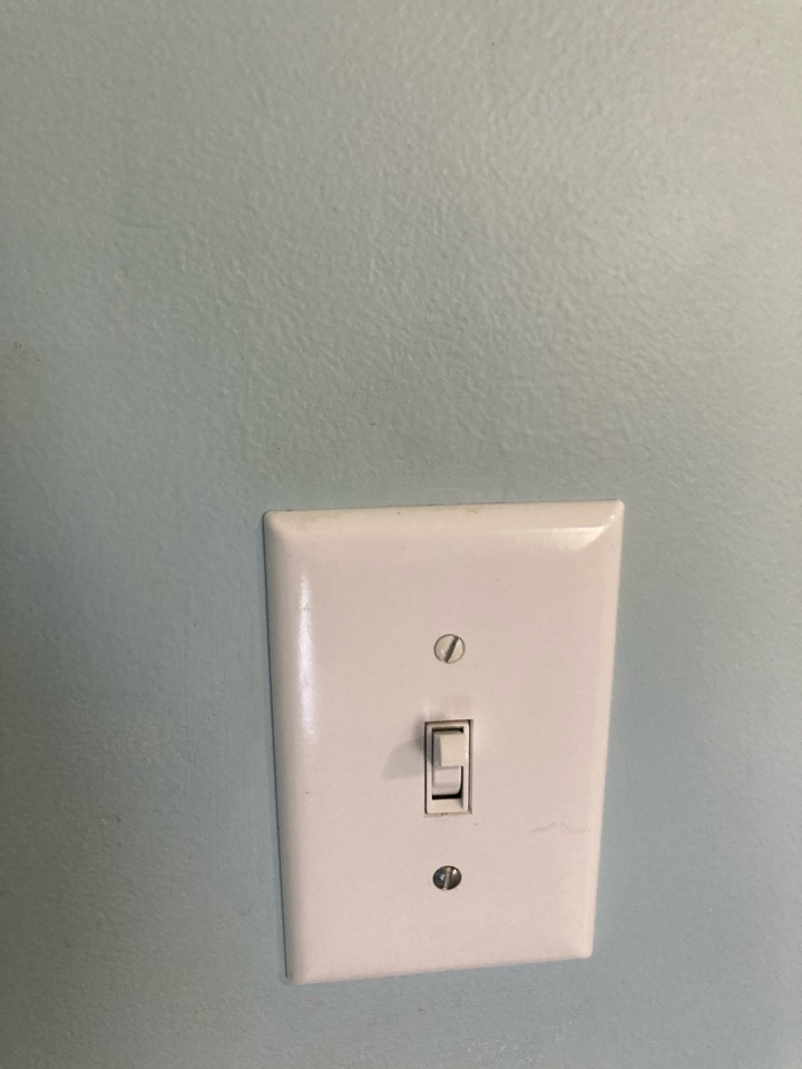 Electrician replacing faulty switch and receptacle.
