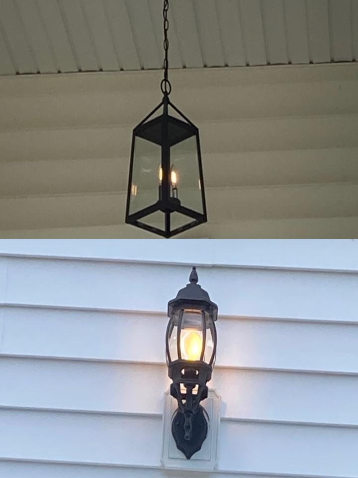 Electrician replacing two exterior light fixtures