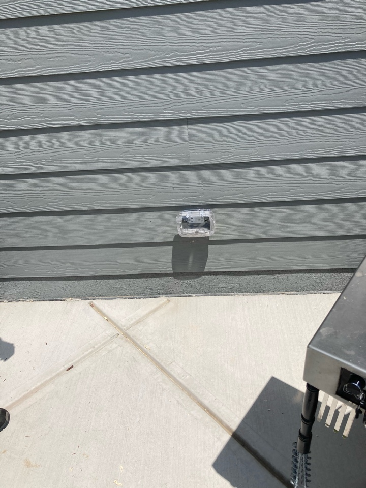 Electrician running power to a patio receptacle for a smoker unit.