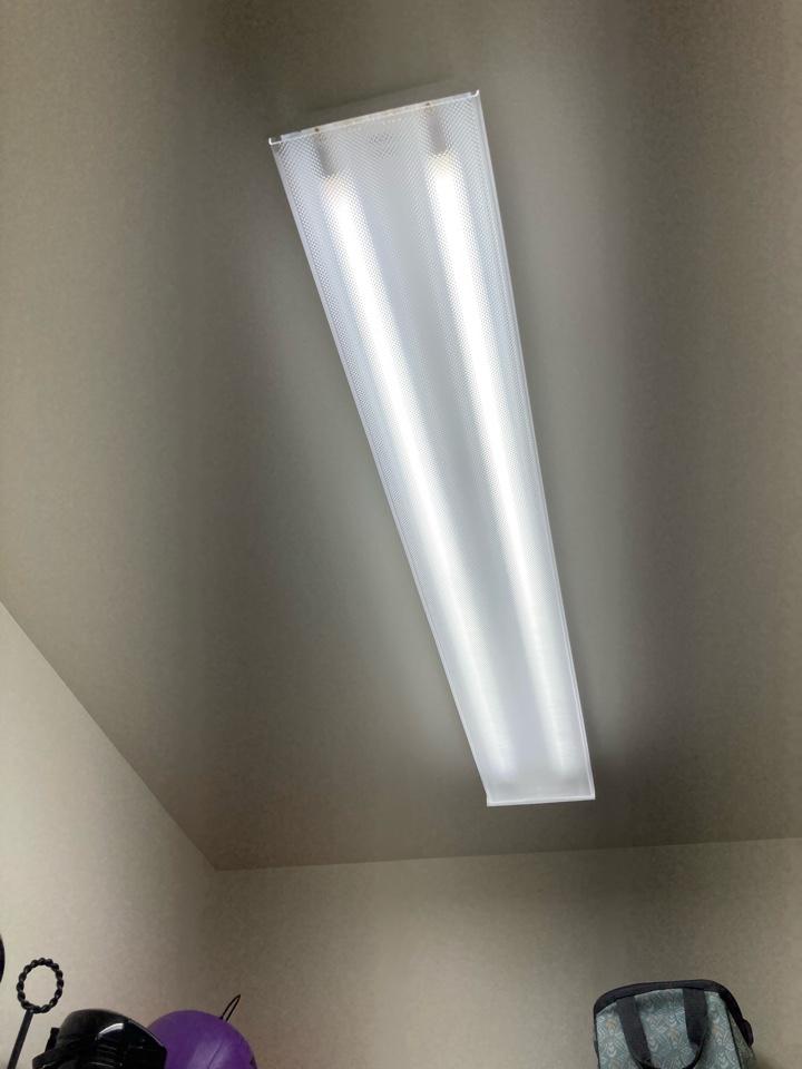 Electrician replacing a faulty pantry light fixture