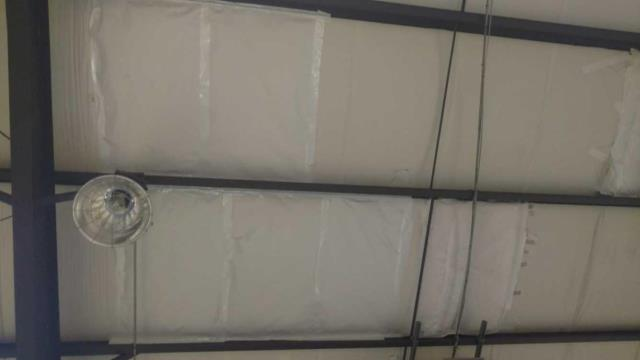 Richmond Hill, GA - Roof insulation repair at local Richmond Hill High School