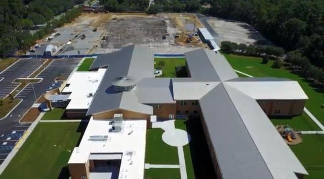 Savannah, GA - New Roof - Commercial Standing seam roofing & PVC roofing - May Howard - Savannah