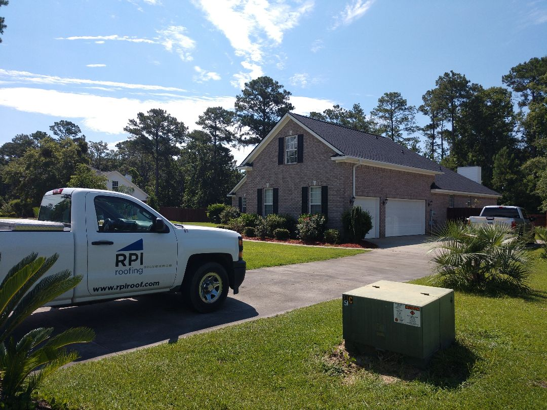 Richmond Hill, GA - Residential roof replacement and new gutter installation.
