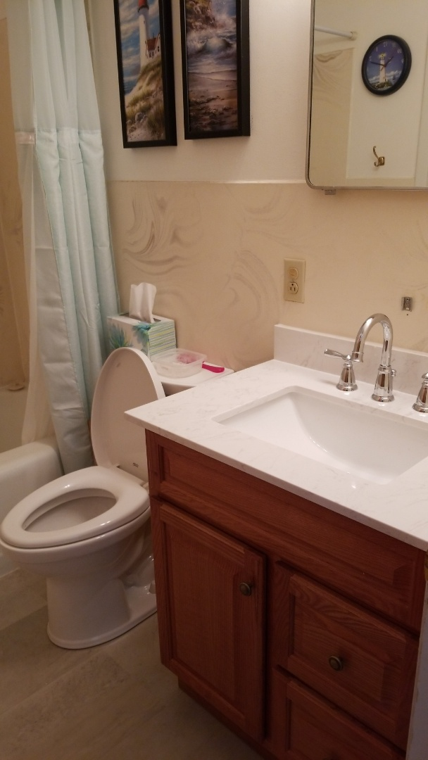 Madison, WI - Replaced toilet and installed American standard right height toilet.  Replace vanity and top with new moen faucet.