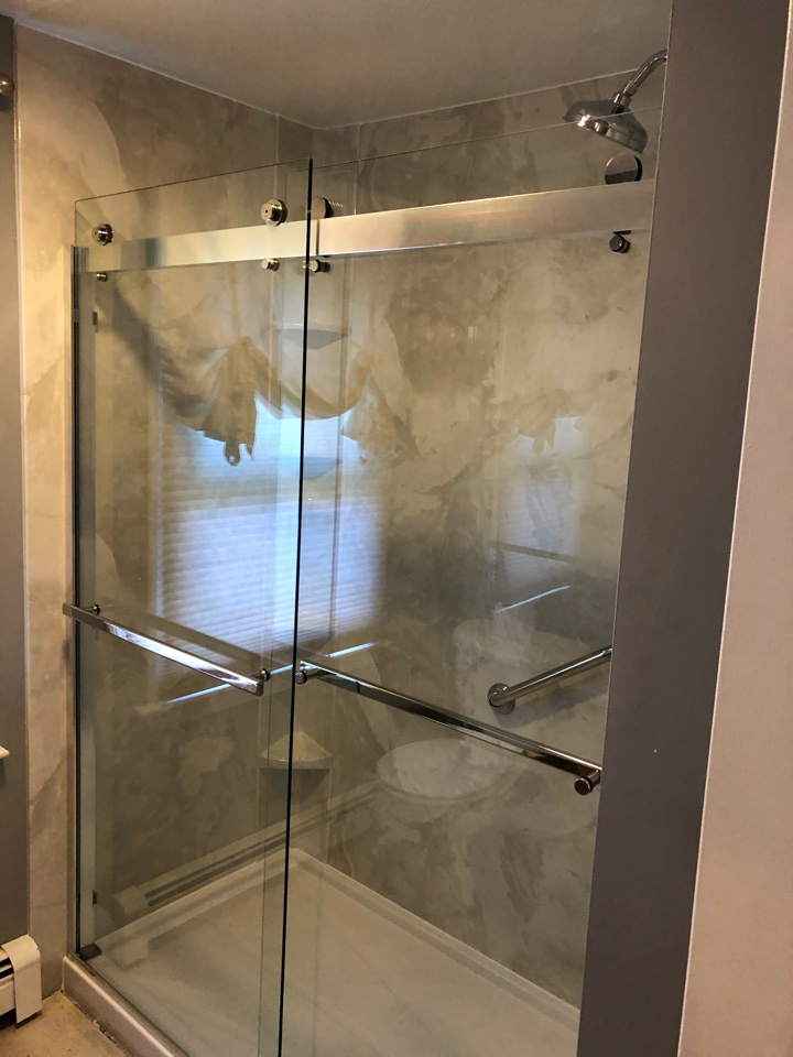 Plymouth, MA - We removed the older worn out tub unit and install a stand up shower with sliding frameless doors . Updated the plumbing with a rain head and handheld unit.