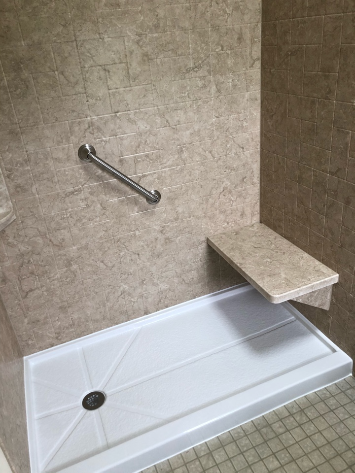 Barnstable, MA - Installed a new stand up shower with updated plumbing . New acrylic shower walls in windmill pattern . Installed all new brush nickel finish hardware and a custom bench .