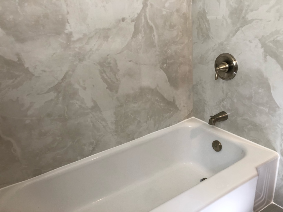 Yarmouth, MA - We installed a bathtub liner over the existing cast iron tub . Finished with silver marble walls.