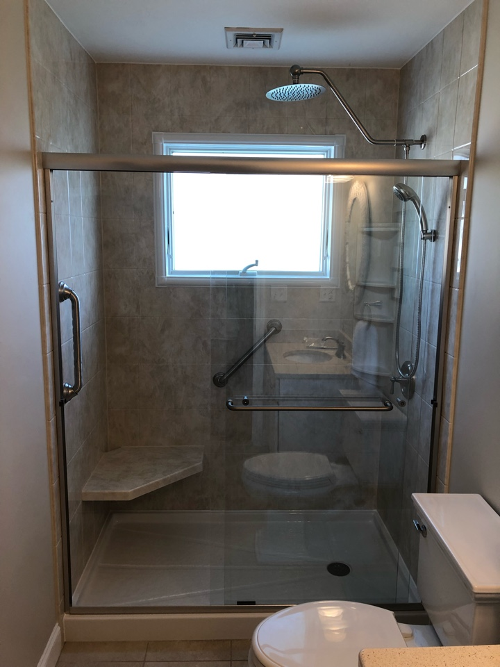Marshfield, MA - We installed two shower in both bathrooms. We mirrored each with 8x10 acrylic walls and shower doors . Updated the plumbing to Moen fixtures .