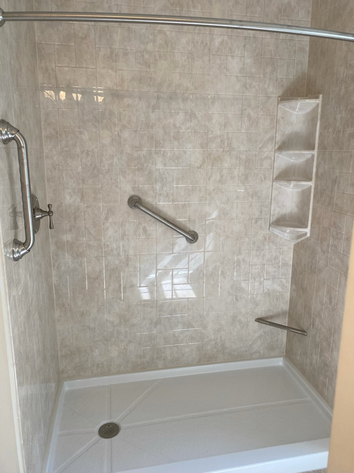 Dennis, MA - We removed the old Jacuzzi bathtub and installed a stand up low threshold shower. Installed a foot rest with 3 grab bars for easy access!