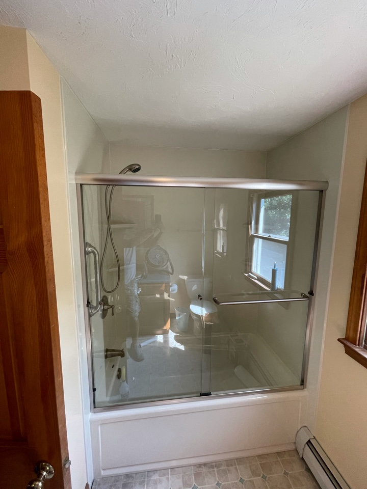 East Bridgewater, MA - We installed a new bathtub with biscuit flat walls . New sliding shower doors in brush nickel finish . Updated the original shower valve with a moen .