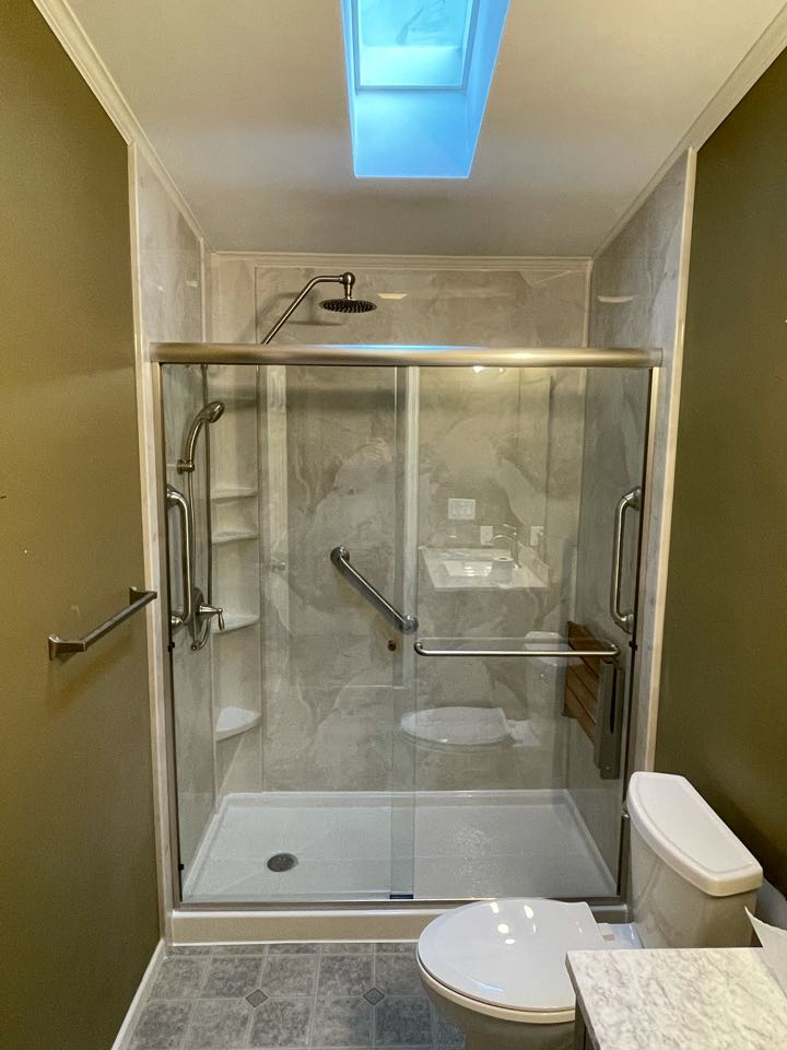 Raynham, MA - Installed a new acrylic shower in place of old fiberglass bathtub . Shower door and silver marble walls to finish the look. Also, installed a new vanity and top.