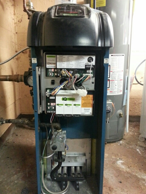 Trevor, WI - Burnham boiler not heating. Found thermostat not wired properly and not working. Replaced thermostat with Honewell focus pro 5000 non programmable thermostat. Also showed customer how to bleed upper baseboard heaters. Boiler now heating properly.