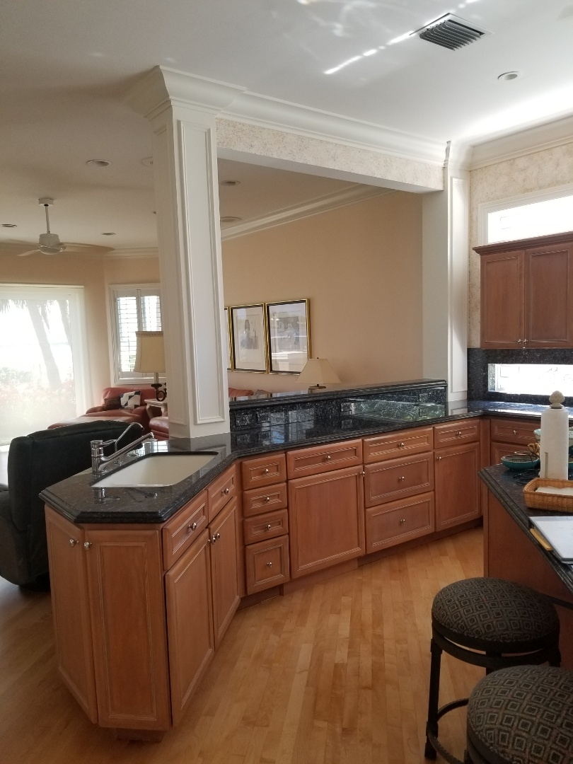Palm City, FL - Finished this beautiful kitchen modification in Palm City. We took upper cabinetry down and installed a support beam to allow for a nice airy passthrough to the living space. Partial remodeling makes all the difference!