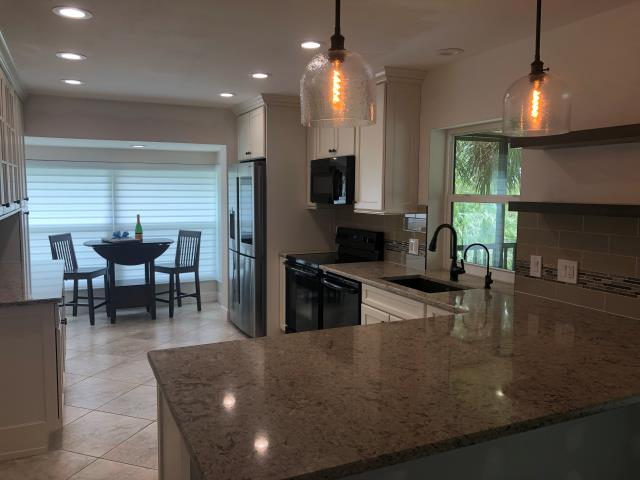 Jupiter, FL - So excited for the client reveal today! The Showplace Cabinets and Cambria Windermere counters turned out great!