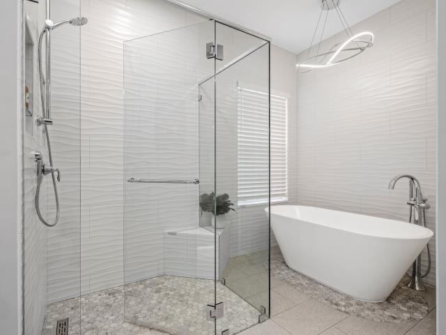 """Palm Beach Gardens, FL - You don't always need bold or bright colors to make a statement. This """"white"""" bathroom in PGA National stuns with its mix of patterns and texture."""