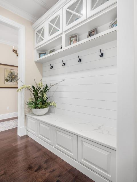 Stuart, FL - We aren't limited to bath & kitchen remodels! Check out this entry area tailored to the needs of this growing family! The shiplap wall offers the perfect finishing touch. Outstanding.