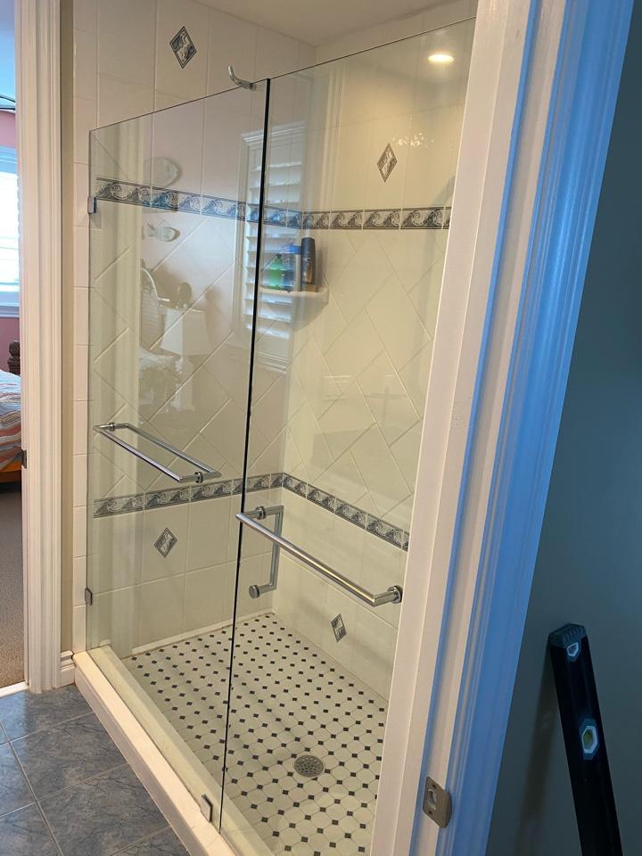 Stuart, FL - Installing new frameless glass units.