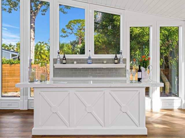 "Jupiter, FL - Happy Friday! Isn't our client's new bar dreamy? Its the perfect fit in their new ""Florida Room"". Cheers!"