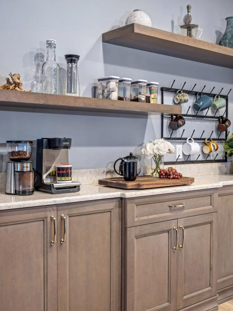Port St. Lucie, FL - Details, details, details! Those floating shelves from Showplace Cabinetry are the perfect addition to our client's coffee bar.