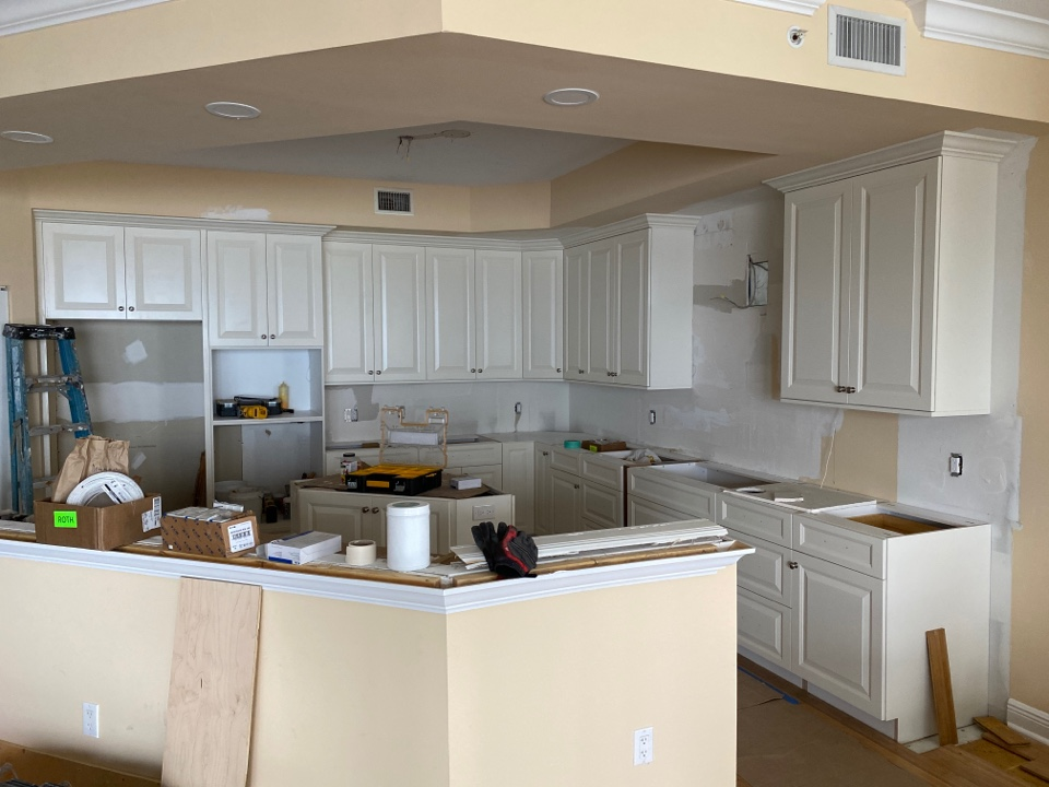 Palm City, FL - New cabinets are all just about in. About her clients anxious awaiting their dream kitchen.