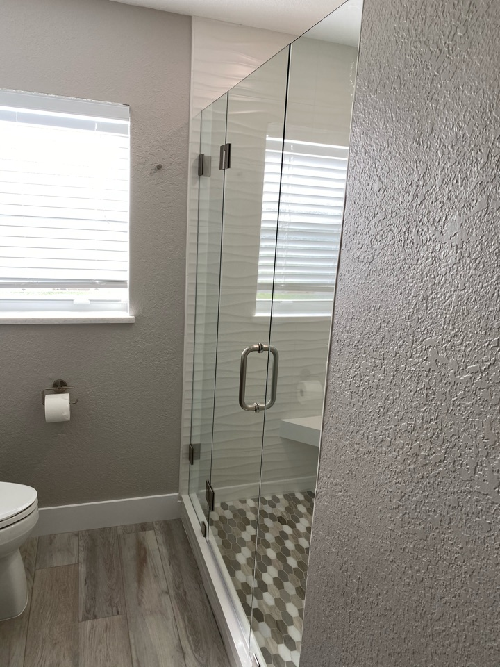 Fort Pierce, FL - New glass shower in newly remodeled guest bath.