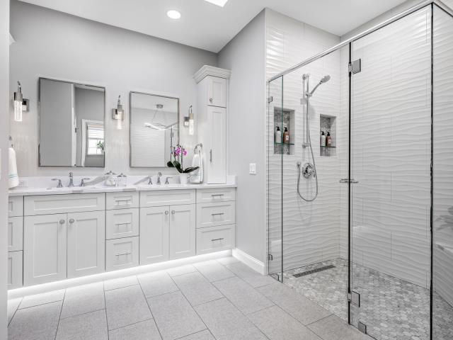 "Palm Beach Gardens, FL - Looking for something to jazz up a ""white"" bathroom? Under cabinet lighting can do the trick!"