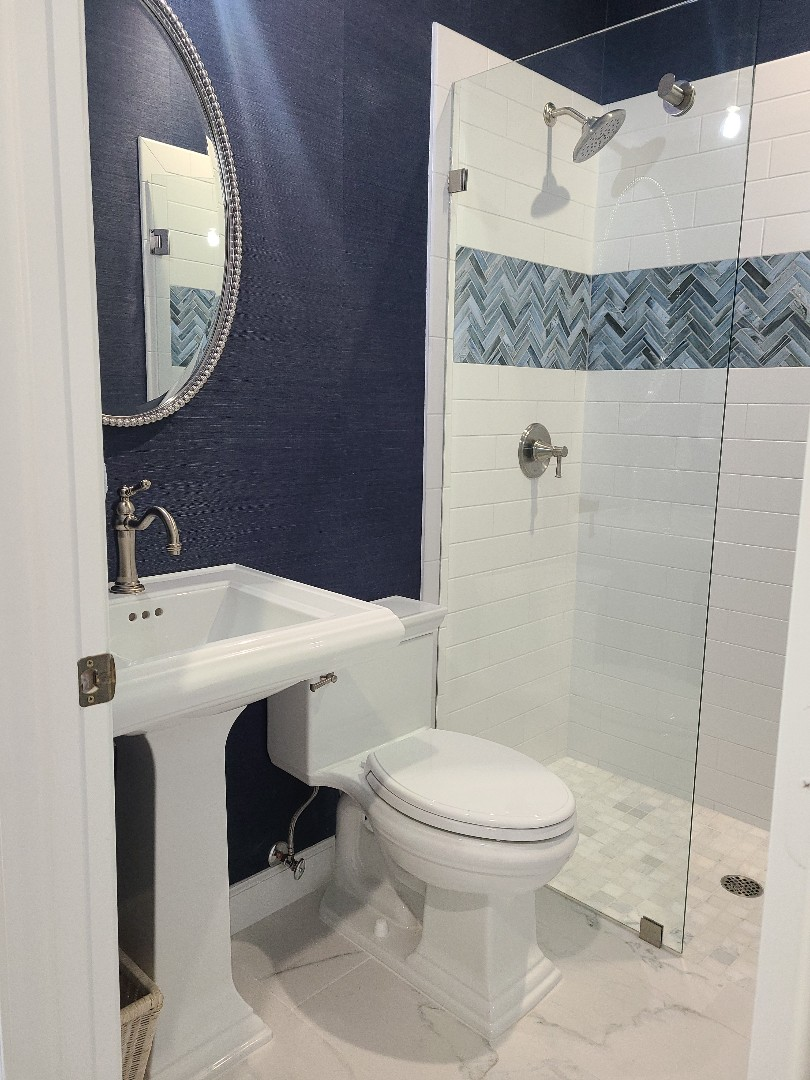 Port St. Lucie, FL - Before we started this bathroom there was no shower. A large powder bath now has a functional shower and is a beautiful room for guests to use!
