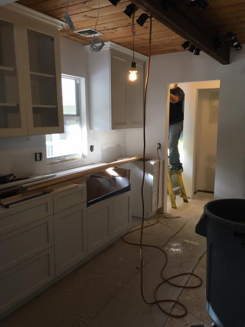 Jupiter, FL - It's a New Year...and we're hard at work this morning in Jupiter Farms. This kitchen remodel includes gorgeous white cabinets by Showplace Cabinetry. Loving the contrast between the wood ceiling & cabinets!