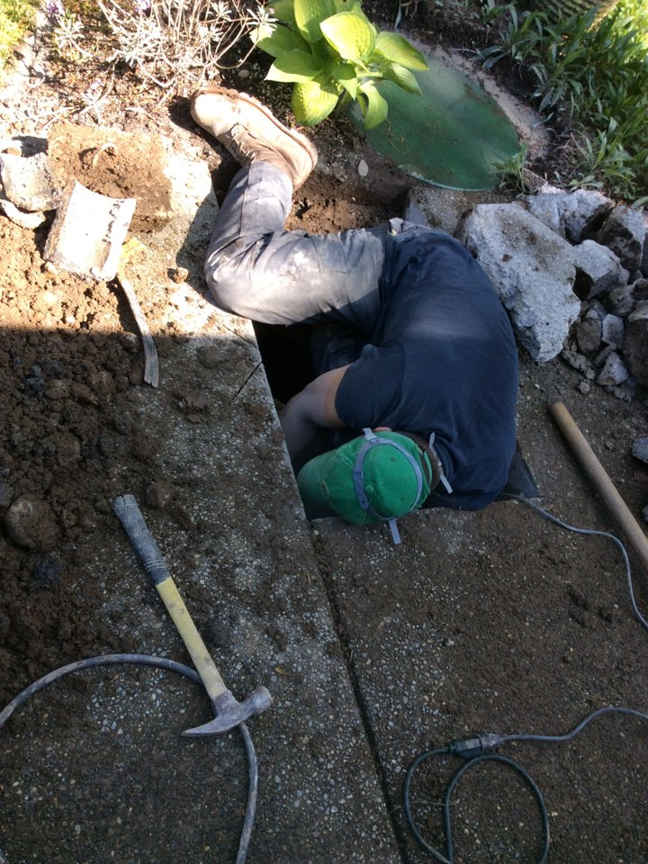 Auburn, WA - Hard at work replacing a baffle on inlet of septic tank