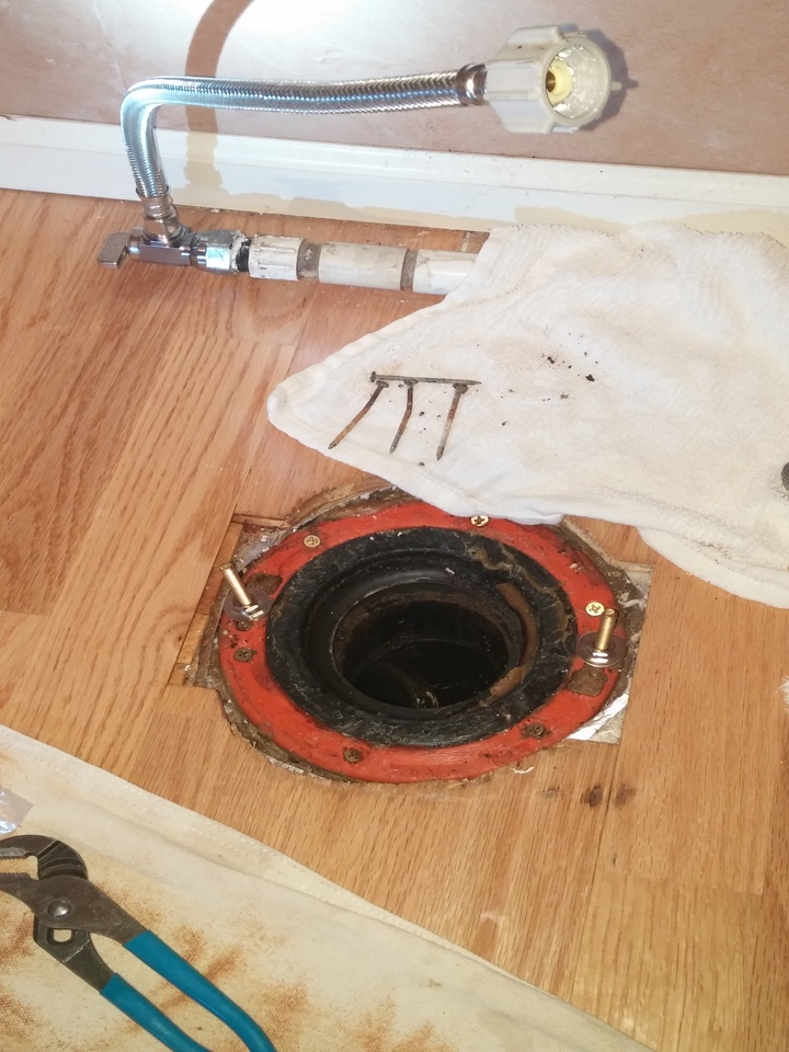 Burien, WA - Securing closet flange, that was improperly installed using nails, by removing nails and securing it with screws. Also installing faulty shut off valve