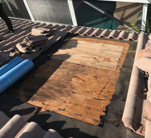 We repaired a leaking tile roof in Lake worth Fl  3346. We removed tiles and found rotten plywood. so we replaced the underlayment and installed new plywood and re tiled the area