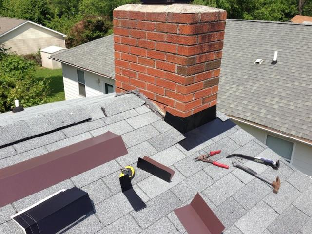 We repaired a leaking chimney on a home in Vestavia Al 35226. We removed the surrounding shingles and re-flashed the chimney.