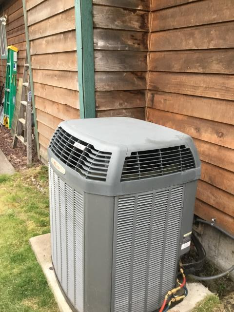 Pacific, WA - In Pacific, diagnosing an air conditioning unit that was not cooling properly. Did a leak searched to the system and found that customer had bad TXV. We were able to order the customer a new TXV to get the unit back up and running!