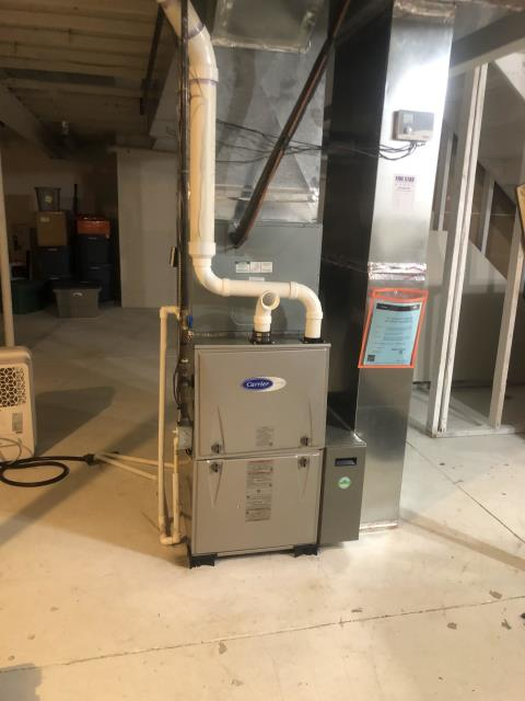 Pataskala, OH - Multiple low voltage wires used for previous setup. Current wiring is unhooked from the furnace. Current wiring is ran across the front of the furnace. Removed both 2 wire and 4 wire thermostat wire. Added 8 wire thermostat wire.