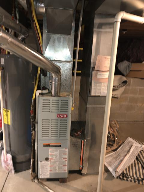 Groveport, OH - Found a 80% Bryant gas furnace in the basement. Found the inducer running on the furnace, pressure switch closes but the ignitor wasn't glowing. Removed plug on ignitor to check ohms across ignitor and found the plug wasn't pushed all the way in and making a good connection. Found 120v to ignitor. Ignitor ohms are at 62. Plugged ignitor back in and checked for a secure fit.