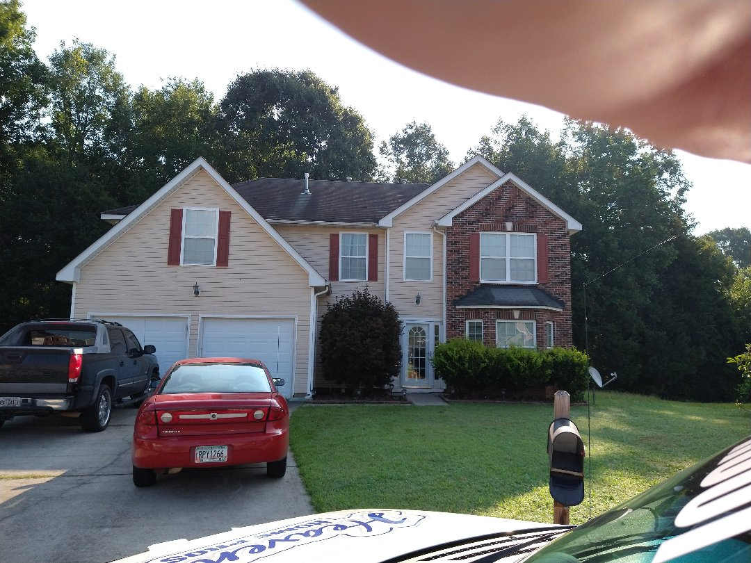 Fairburn, GA - Meeting with insurance roof adjuster to inspect roof for wind damage