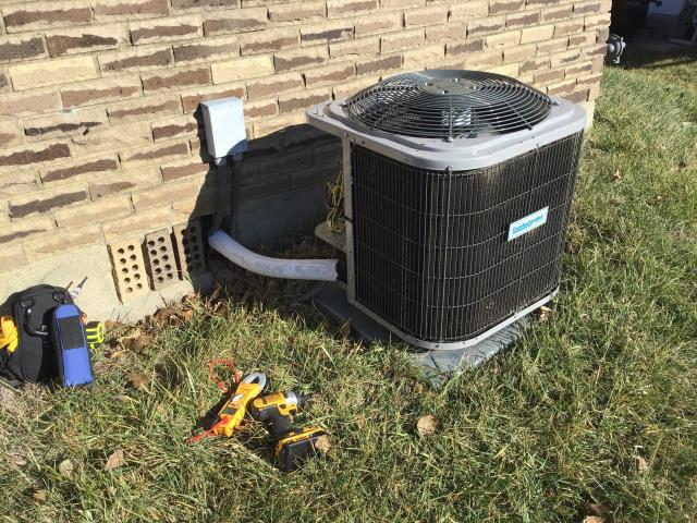 Wilmington, OH - New homeowner states that the compressor is making a loud noise. The technician hooked up gauges to test the amount of refrigerant in the system. It read low. We will need to return in the spring to properly diagnose the issue when the temperature is warmer.