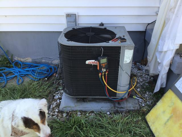 Kettering, OH - Performing our Five Star Tune-Up & Safety Check on a Lennox AC unit. Found unit was low on refrigerant, added 1 lb  of R-410A Puron. Leveled the unit using isolation pads. System operational upon departure.