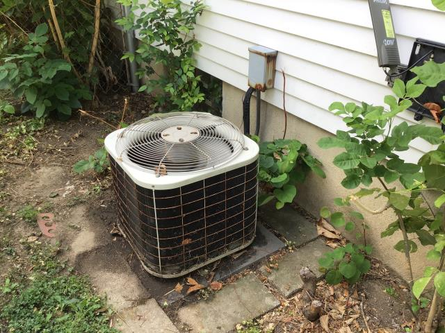 Kettering, OH - Performing a Tune Up & Safety Check performed on the 1996 Customer's Air Conditioning Unit.