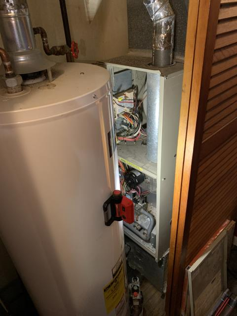 Wilmington, OH - Here for a no heat on a 28-year-old Arcoaire furnace. On arrival found furnace not coming on and flashing a number three fault on the control board. This indicates a pressure switch open. Checked tubing coming from pressure switch to collector box and found the little metal port that the hose connects to is completely impacted so hard it seems like concrete. Was not able to get this port cleared out, this is also very in accessible due to the fact that the hot water tank is installed right in front of the front part of the furnace that is inside the closet sideways facing directly at the hot water tank.