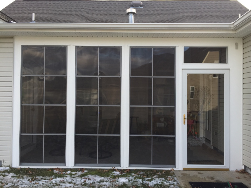 Middletown, DE - A PGT EZ-Breeze Vinyl 4 Track Porch Enclosure Room recently installed by Homecraft, Inc.
