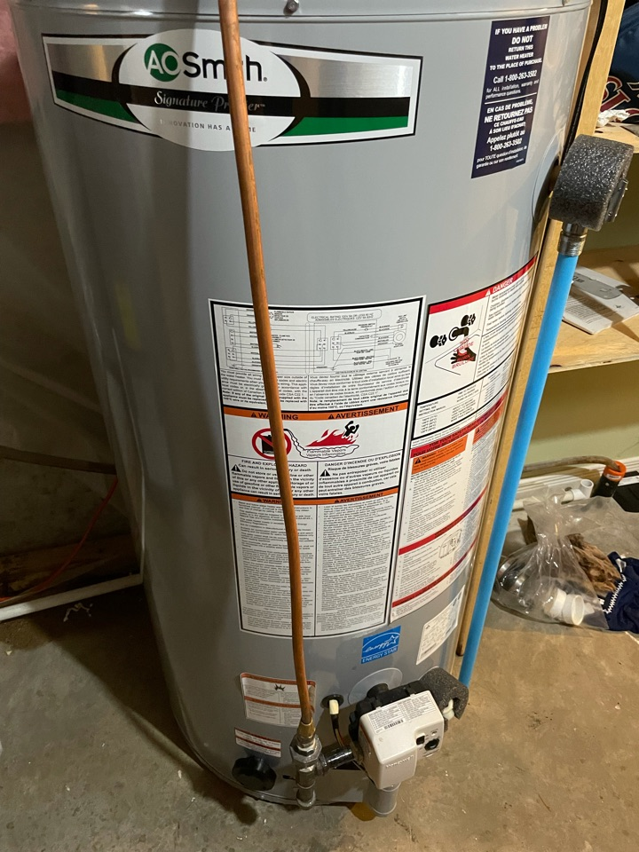 Install customer provided hot water heater in Guelph